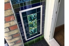 Porch tiles with William De Morgan fantastic animals panel