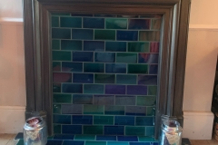Debenham blend tiles set into firplace