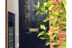 Deep-blue-porch-tiles-with-William-De-Morgan-Bedford-Park-Insets