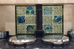 Aga panel using Wiiiam De Morgan decorative tiles and flying leaf spacers