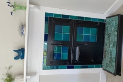 Bread oven using blue and turquoise bespoke tiles