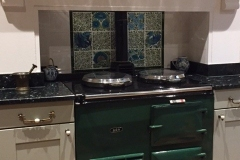 Aga panel using William De Morgan decorative tiles and flying leaf spacers