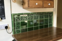 Olive splashback with tulip border and dado surround.