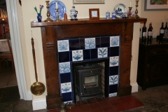 William Morris floral tiles with deep blue spacers